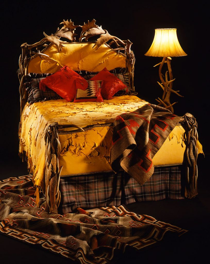 antler bed with leather bedspread